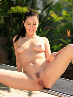 Free nude gallery of hot Latina girl Alina Lopez takes off her skirt and exposes her perfect ass and tasty pussy outdoors.