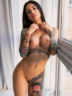 Free nude gallery of sexy brunette babe Gina strips off her red top and jean shorts and exposes her sexy curves in front of the windows.