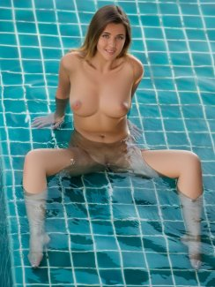 Sexy blue-eyed Kailena strips naked by the pool and exposes her stunning wet body.