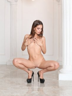 Free photos of sexy and leggy babe Karla strips naked and exposes her perky tits, tight ass and nice shaved pussy.
