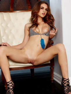 Stunning brunette babe Kasey Chase spreading on the chair and penetrates her sweet pussy with a dildo
