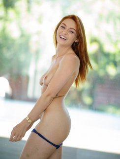 Free nude gallery of naughty pornstar Lacy Lennon takes off her bikini and exposes her small tits and hairy pussy.