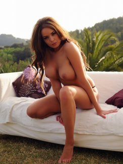 Liberty`s big tits are instantly on display as she poses topless on a couch in the middle of a field, the bright white furniture contrasting nicely with her brown hair and her soft, tanned skin. Her breasts are a thing of beauty, fairly large and round with tiny nipples to grab your attention.