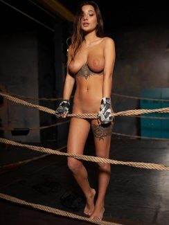 Free nude gallery of tanned beauty Medina Q. stripping naked and exposes her amazing tattooed body in boxing ring.