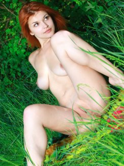 Here we have a very very sexy redhead named Violla enjoying a nice naked picnic outside. This girl has certainly got it.