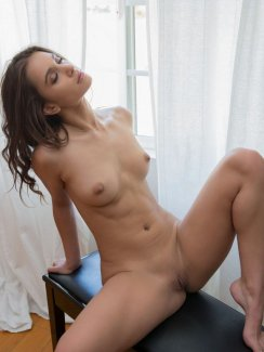 Free nude gallery of beautiful Uma Jolie strips off her oversized tank and black panties and exposes amazing body.