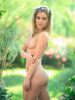 Free nude gallery of blue-eyed pornstar Zoey Taylor gets naked and demonstrates her firm ass and shaved pussy outdoors.
